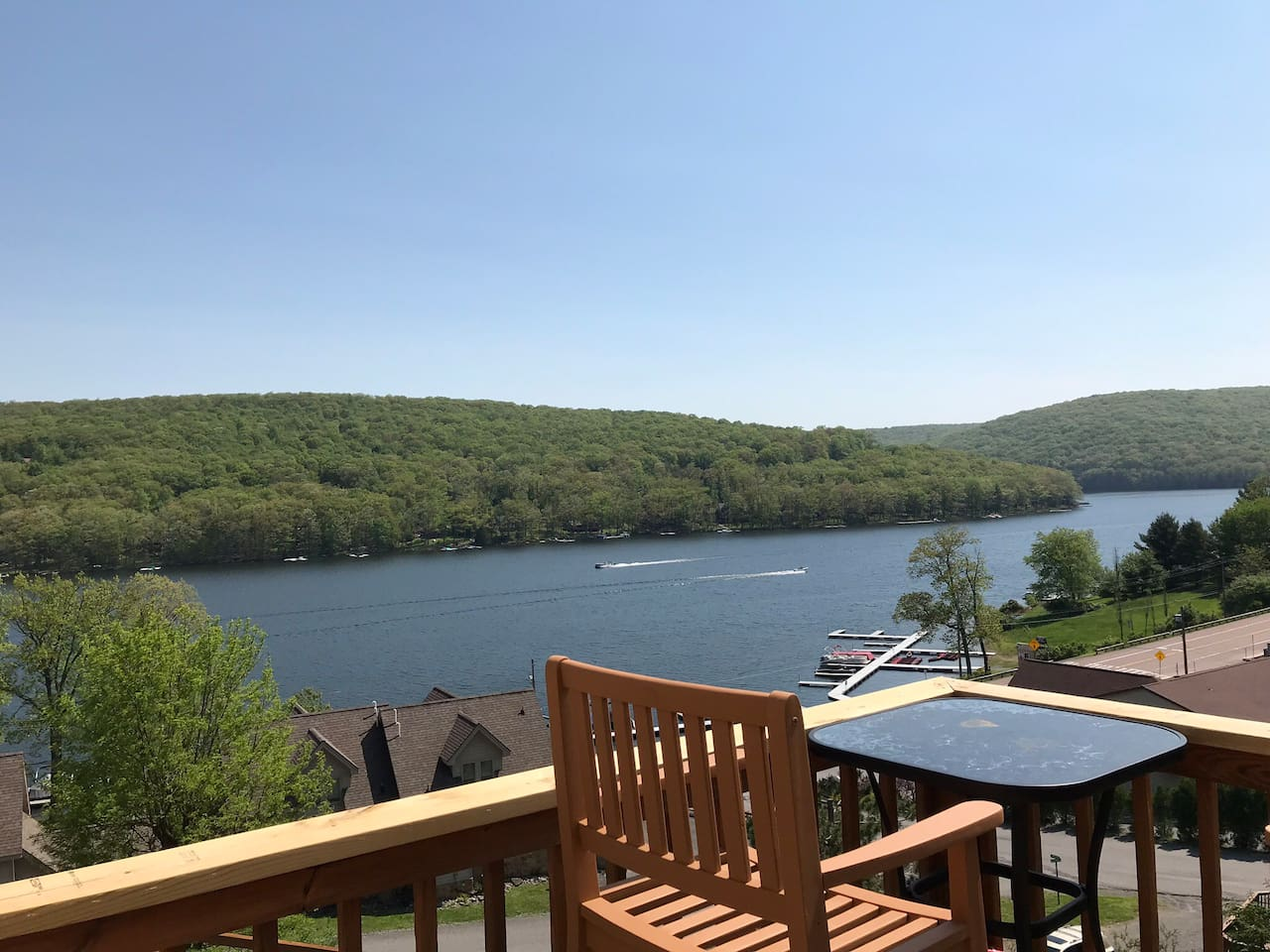 View of the lake from private deck with table and 4 chairs
