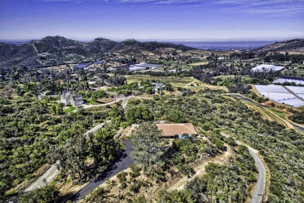 Arial view of property and surroundings
