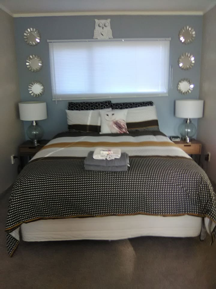 Room has recently been upgraded and painted, own pull out sofa, microwave, table and chairs, cabinets, cereals,jug, toaster, fridge, plates etc, mirror, all for your convenience, just pop into house for shower and toilet