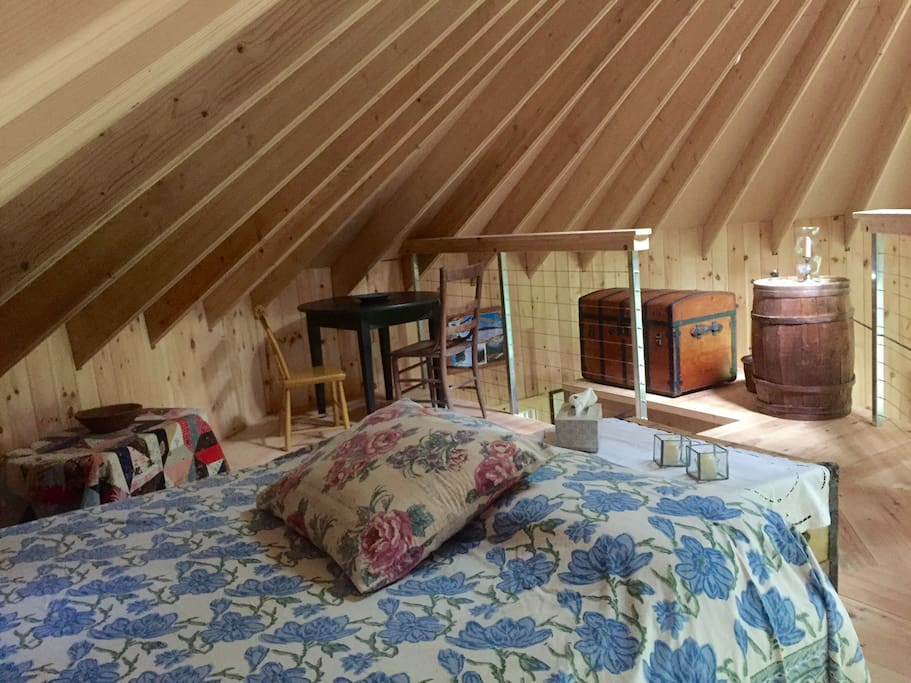 The bedroom upstairs has an amazing view and a comfy queen size bed.