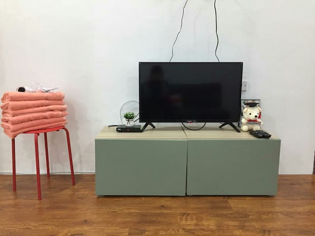 TV with Astro Njoi Towel and hair dryer is provided