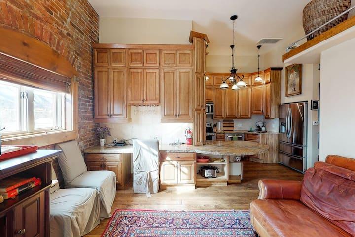 Stylish, downtown condo w/ loft, kitchen, & fireplace plus shared patio & grill