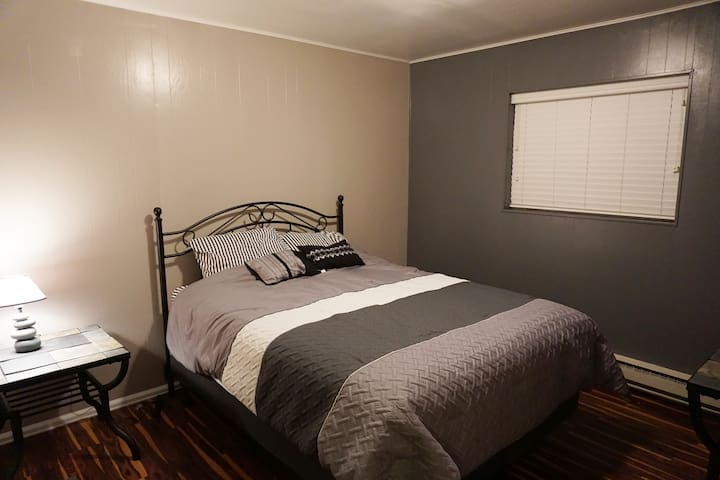 Bedroom 1 (Master) adjoins the bathroom. Queen Bed, closet and dresser.