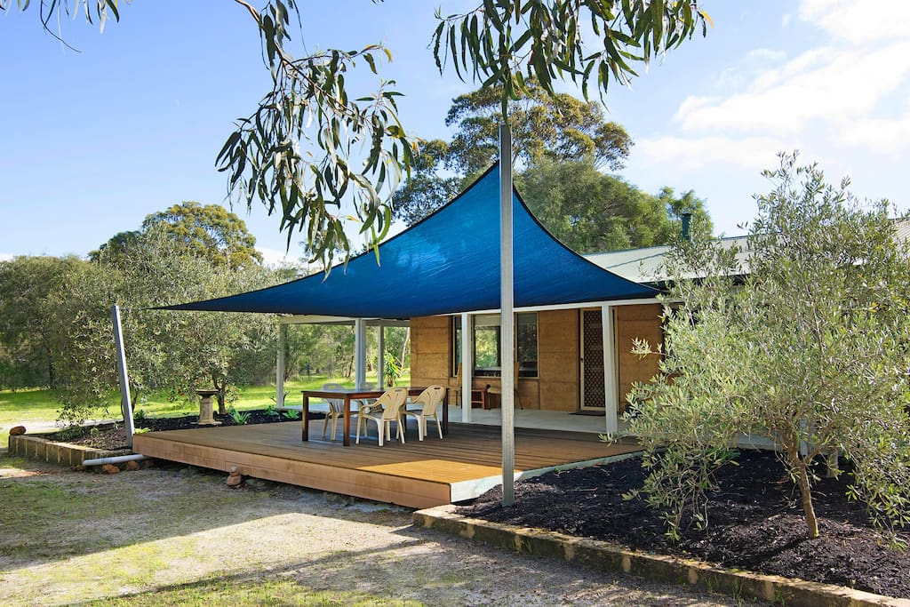 Rear Southerly aspect facing shared bushland, with entertaining deck and  plenty of space for the children to play