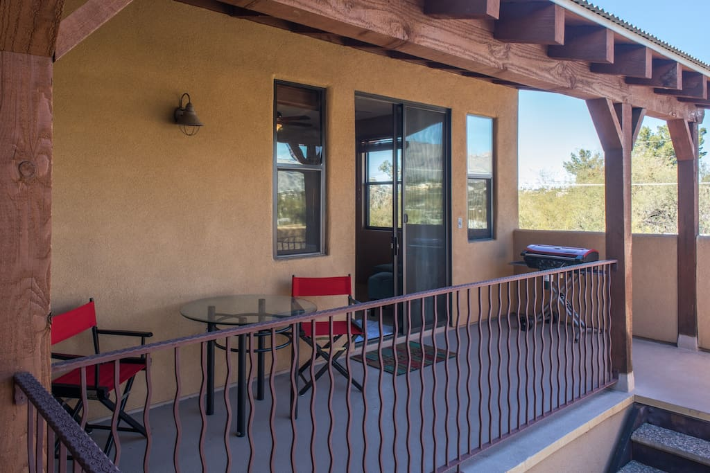 Your private entrance and porch, with an outdoor dining area and grill.