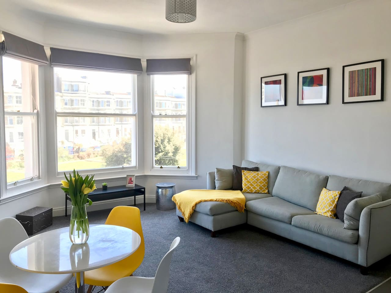 Enjoy sea views from the sofa! Open plan living room / kitchen with lovely views over Dalby Square gardens, Edwardian buildings and the sea.