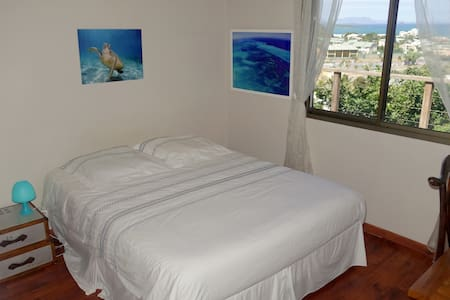 """Bedroom named """"turquoise dream"""" with sea view"""