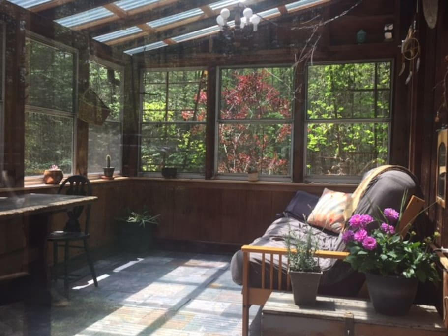 Our garden sun room is great for relaxing on the couch / futon in the sun during the day and star gazing at night.