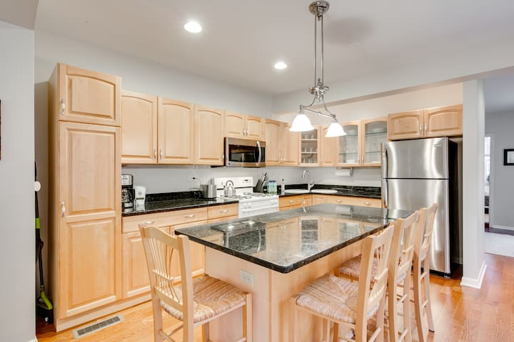 The kitchen island provides a perfect dining space