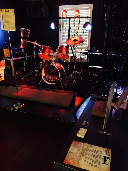 Our main stage rehearsal room, equipped with full backline, Mackie PA, LED lighting and is set up with intimate audience seating for events and showcases, etc.