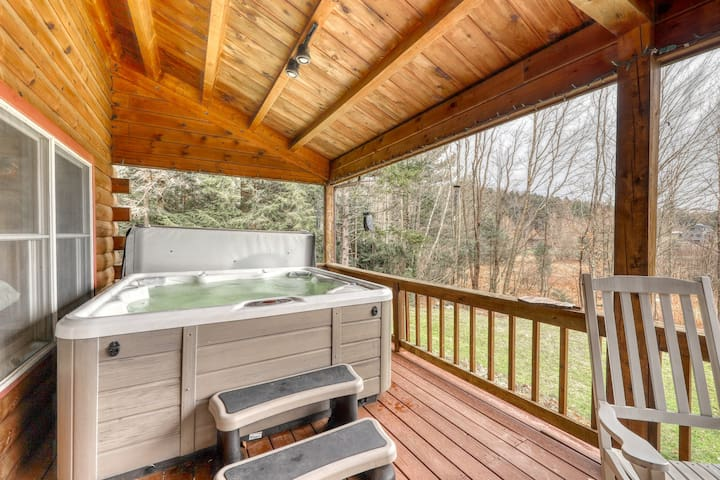 Modern & rustic home w/ spacious deck, private hot tub, fireplace & forest view!