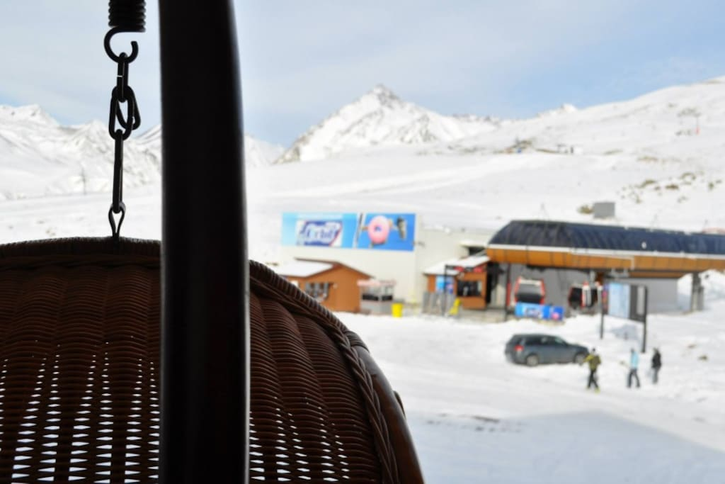 Porch swing with view of ski area