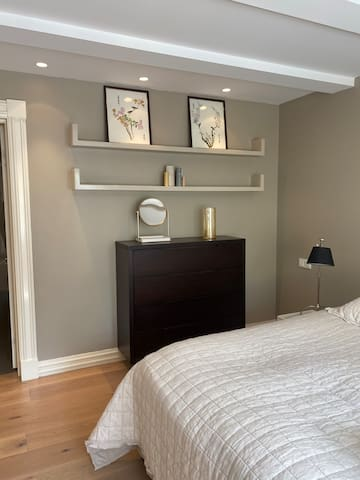 A bedroom with a very comfortable king size bed and warm down feather covers. Also includes a bunk bed. A baby crib is available upon request. A spacious walk-in-closet adjoining