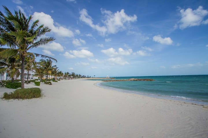 Vacation is a step away from a white sand beach