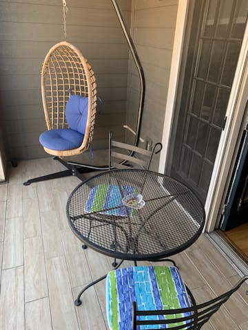 Your patio...the swinging wicker chair was Jessica's baby bed in the early 80s!