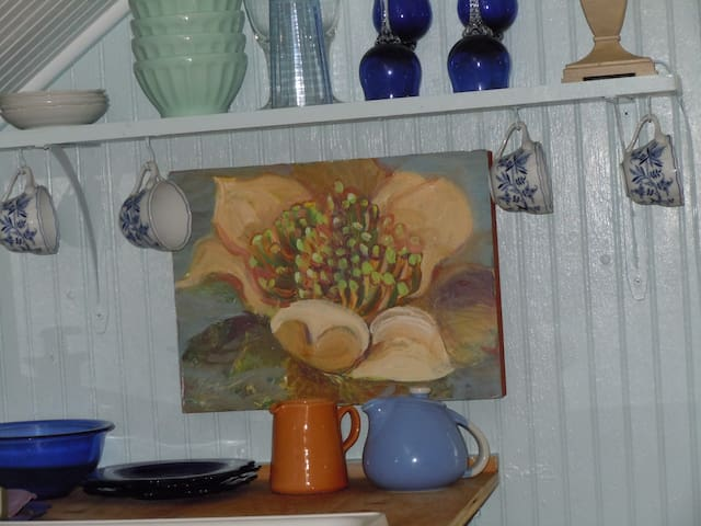 detail of kitchen shelf and my art
