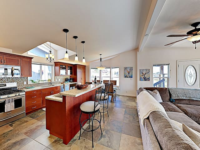 A recently renovated kitchen provides a full suite of brand-new appliances.