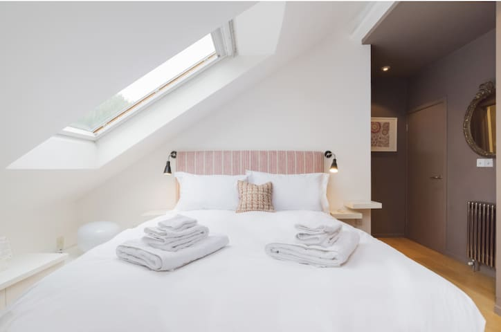 Bedroom 1 Queen Bed -Let the sun in with the Velux skylight, or use black out blinds.