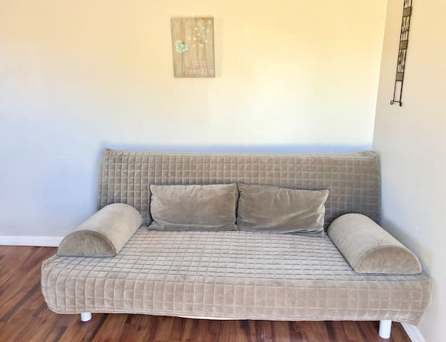 This futon in the den/4th bedroom is comfortable to sit on as a sofa, can be used upright as a twin size bed, or unfolded to a full size bed.