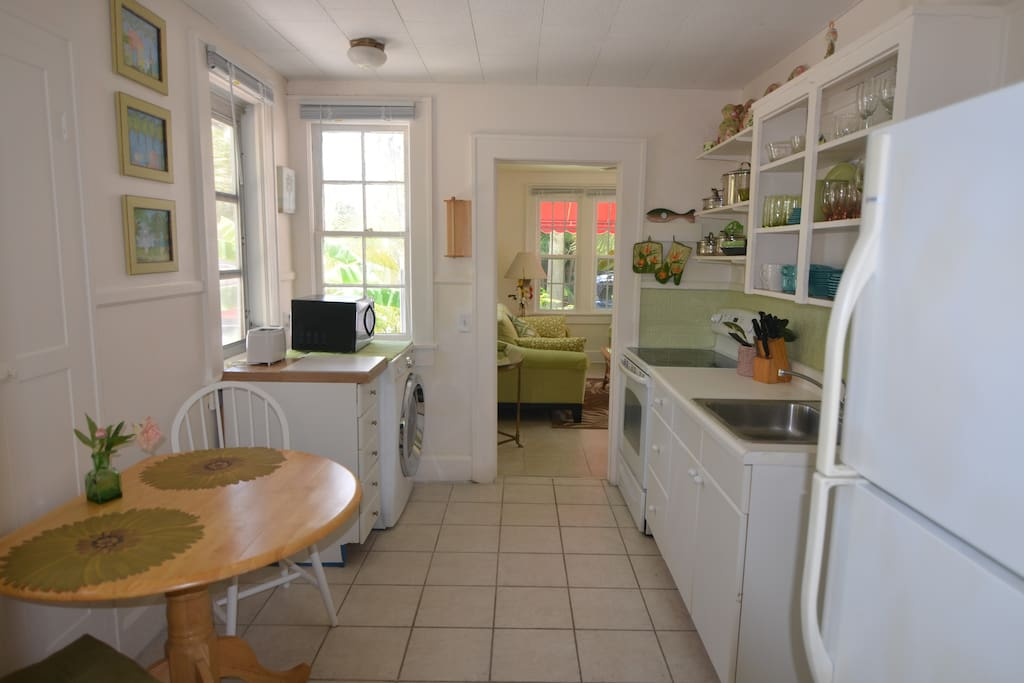 KITCHEN WITH CLOTHES WASHER, CERAMIC STOVE TOP, SINK AND FULL SIZE REFRIDGERATOR