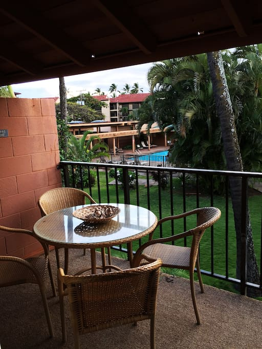 Part of the view from the HUGE lanai over the pool area and lush tropical landscaping.