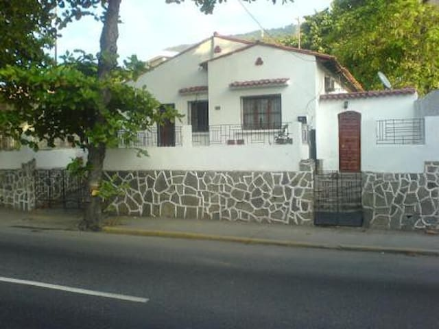 Colonial house near shore and airport +maid +food
