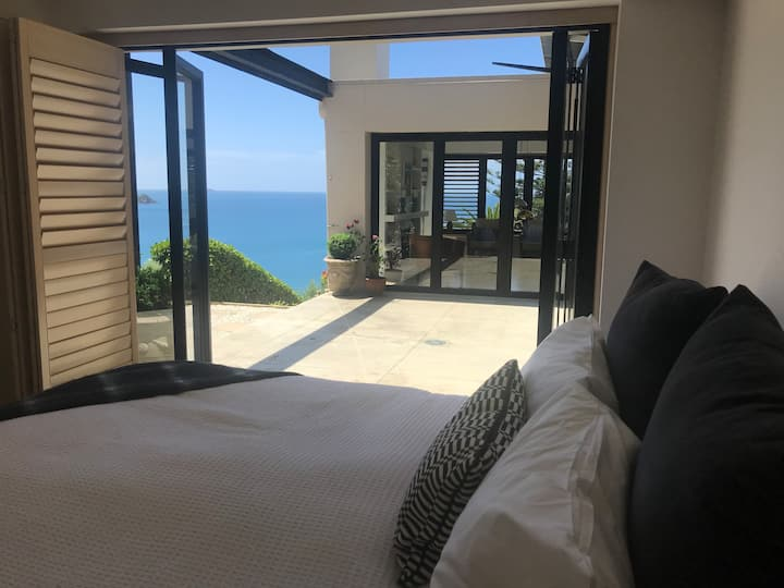 Luxurious guest suite in cliff top beach house.