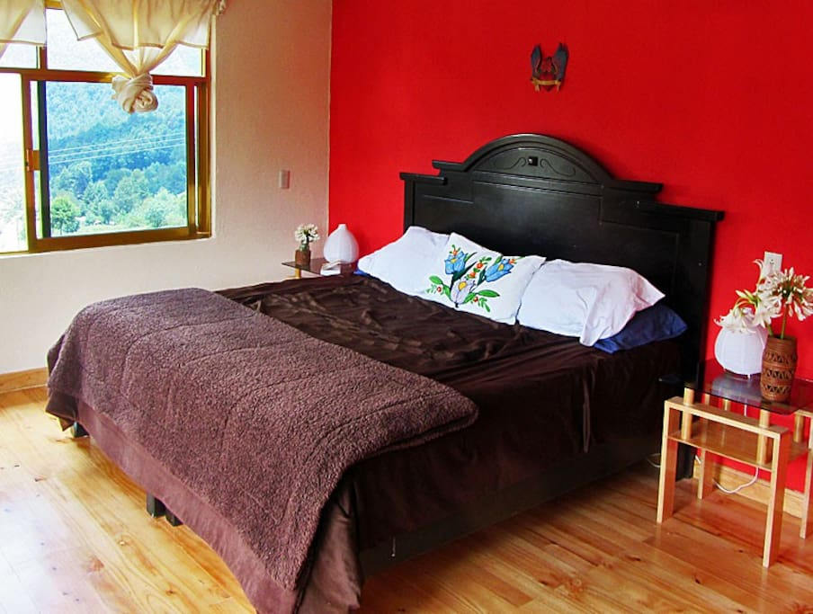 We have three red rooms, 2 with kingsize beds, one with double, all with great views of the mountains.