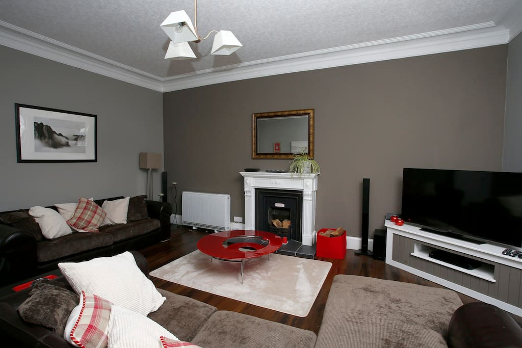 Living room with 55inch smart TV and blue-ray dvd player and surround sound system