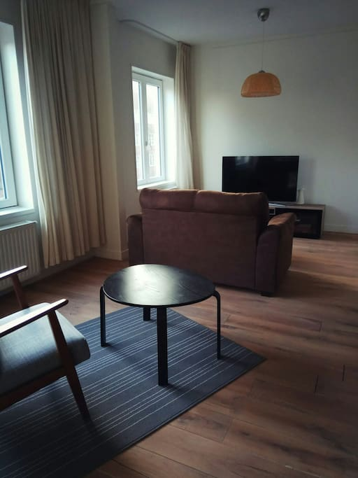 living room with huge TV