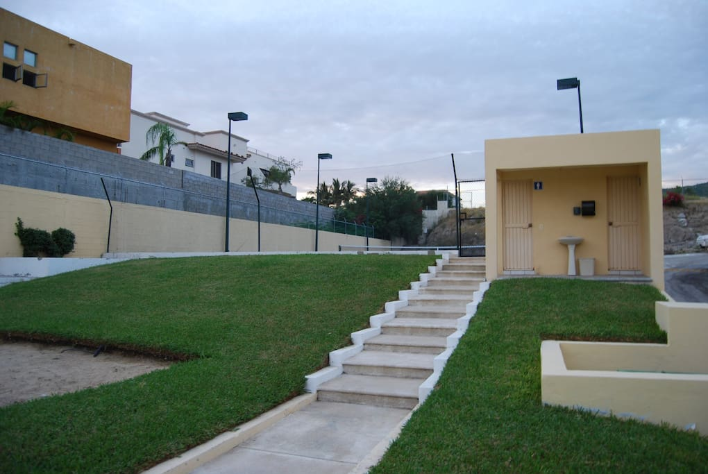 Access to tennis courts & restrooms.