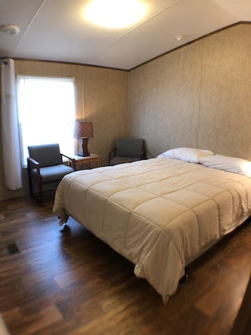 One of the two bedrooms in the trailer house that has one queen sized bed. Sleeps 2 here.