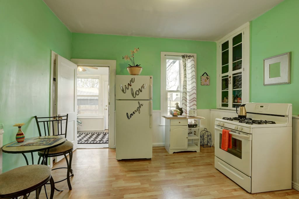 Large, bright kitchen opens onto sun room