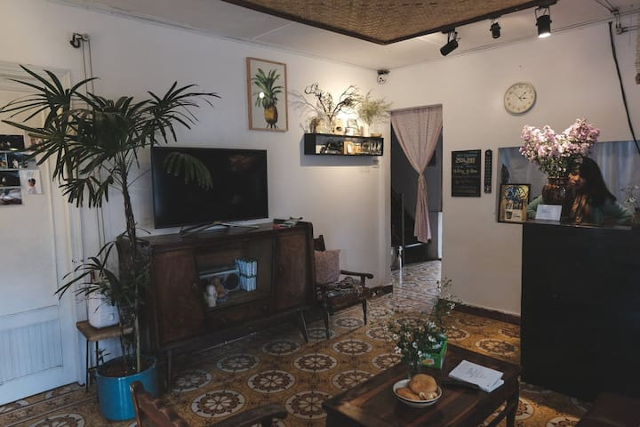 The living-room has a tea table with hot tea always ready, mulberry candy, TV - Netflix which guests can watch full HD movies