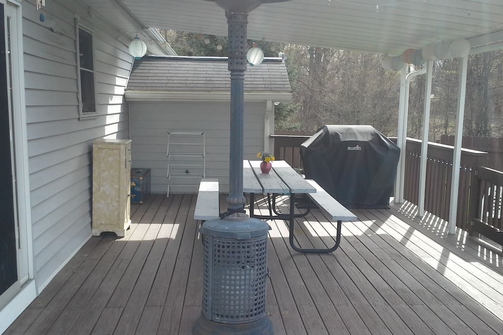 Back Deck.  Perfect for outside dinners, access directly to kitchen through sliding glass door. BBQ grill, lighting, Deck Heater, 8 ft picnic table & 2 seat pub table.
