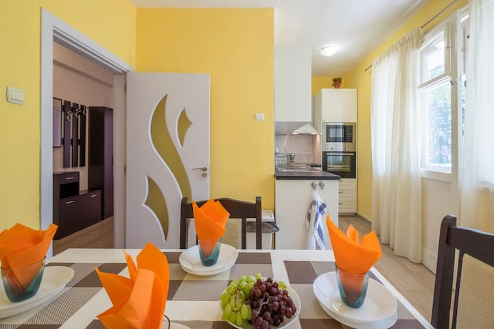 Bright, sunny and fully equipped KITCHEN + dining area with access to the balcony