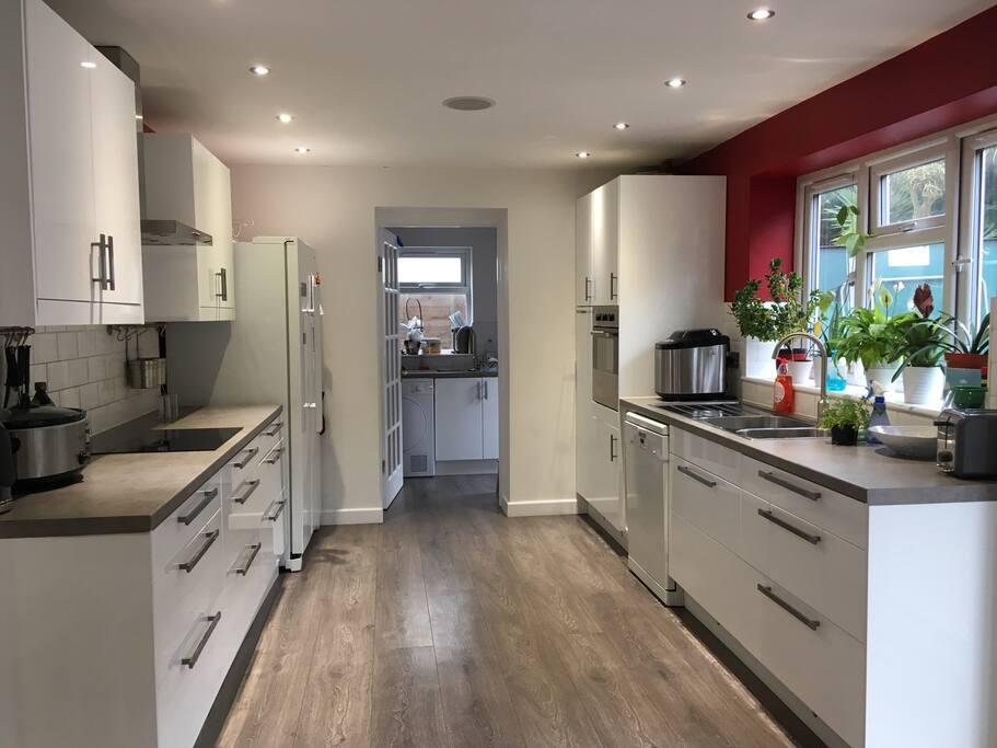 Kitchen/diner with dishwasher and large fridge