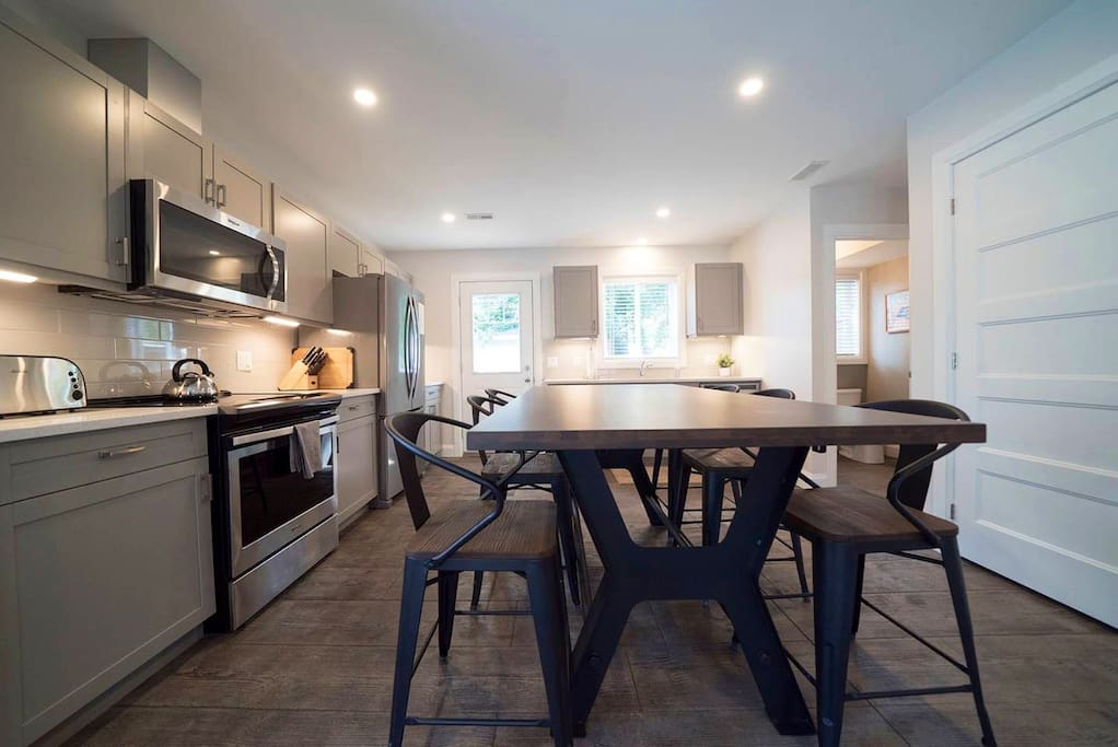 Open concept, brand new kitchen with all the amenities and a big table to enjoy time with friends.