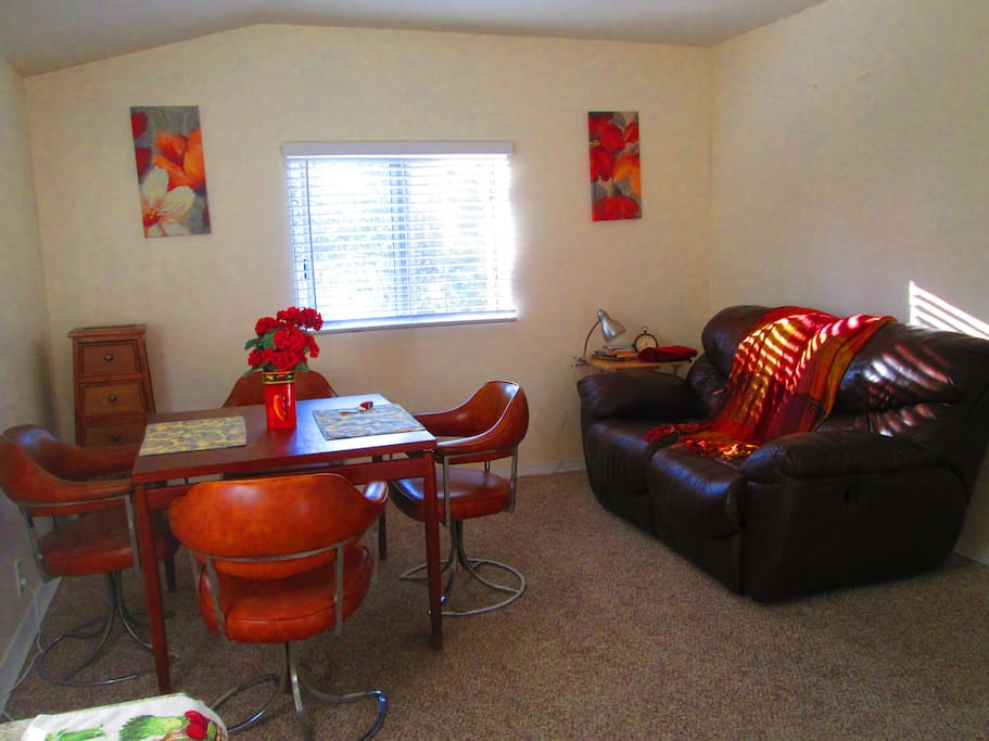 Comfortable dining area with love seat to curl on together. ..