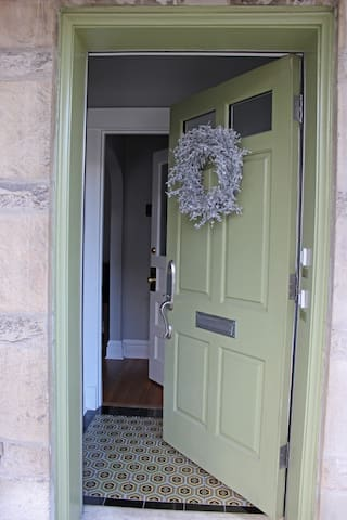 The entryway and door to the 1st floor unit. For safety we keep the porch and foyer lights on all night.