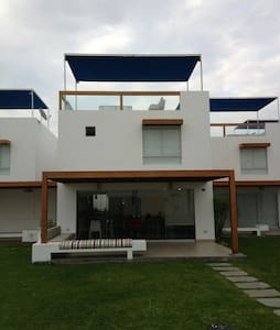 Brand new beach house located in Lima's best beach area Asia Km 108. It comes with everything you need for your (website hidden) has a kitchen, oven, fridge and microwave. Comes with TV. House has a beachfront. With the beach just outside your doorst