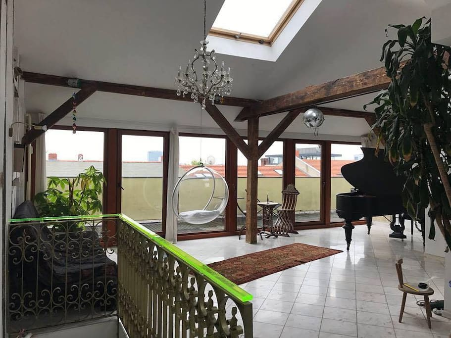 Living room with piano and roof terrace
