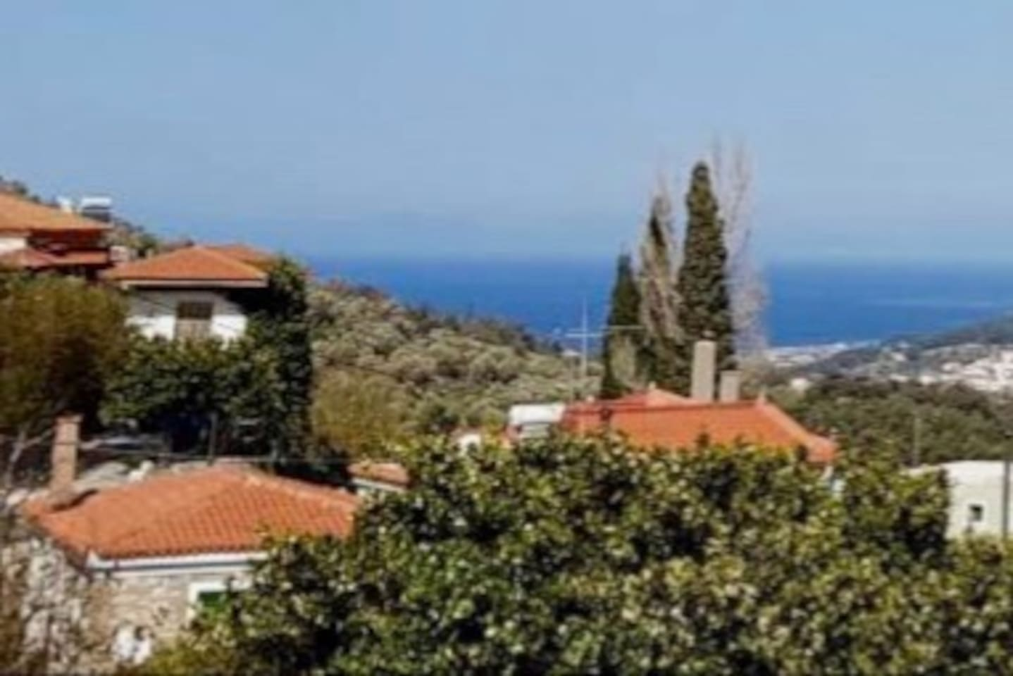 House view over the traditional village to the sea