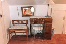 The desk and midcentury modern chair are perfect for working or for getting ready before going out.