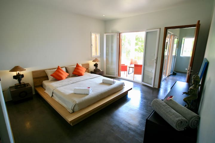 Master bedroom on ground floor with direct access to the garden