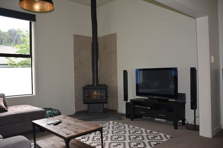Enjoy some entertainment on the flat screen with 5.1 surround sound next to a cosy fireplace for the colder months.