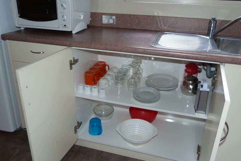 Kitchen cupboards include a wide range of equipment.
