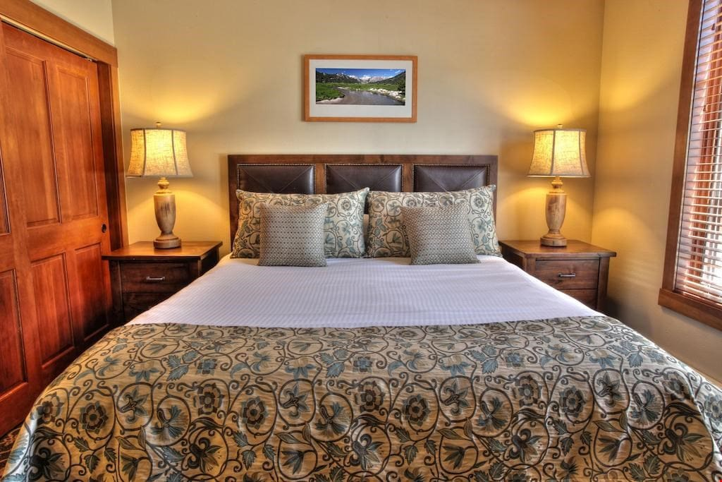 The master bedroom has a luxurious king-sized bed.