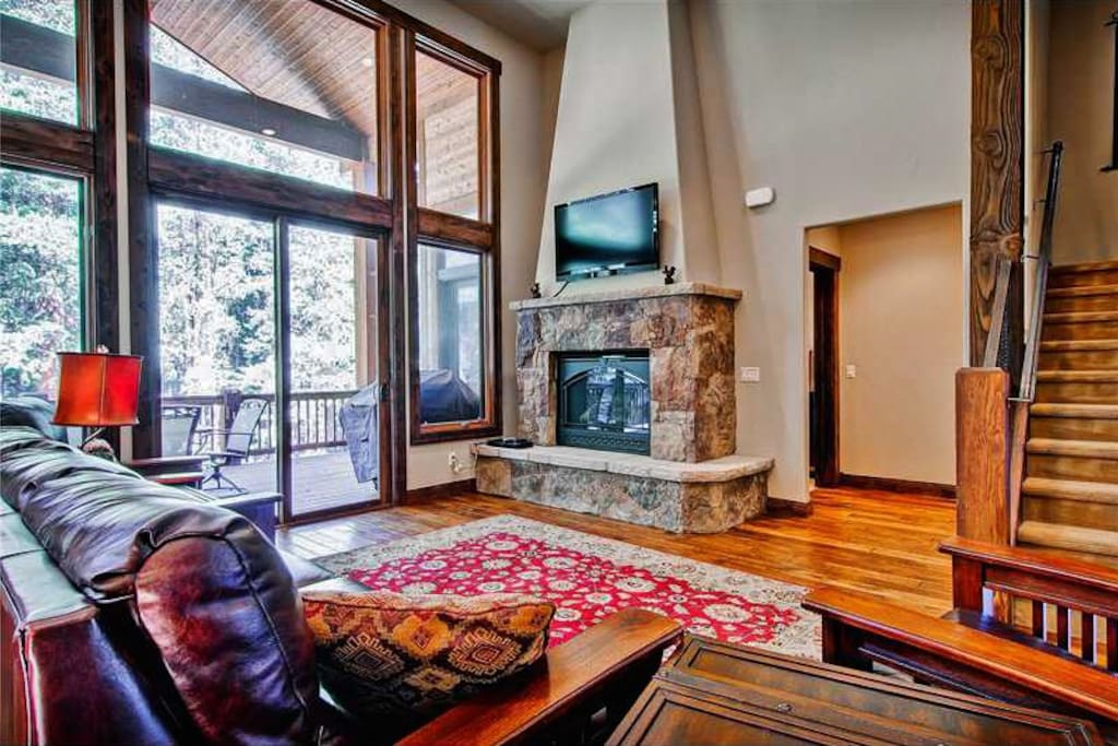 Cozy up in the inviting main floor living room next to the warmth of the fireplace.