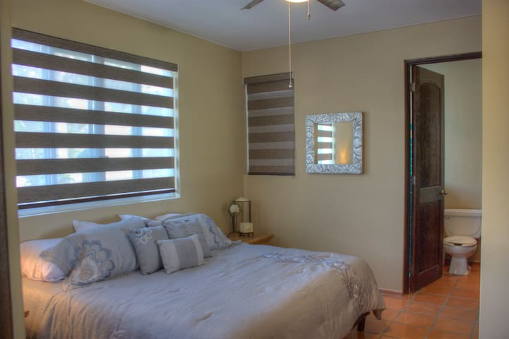 The center bedroom has a look screen shutter to the living room
